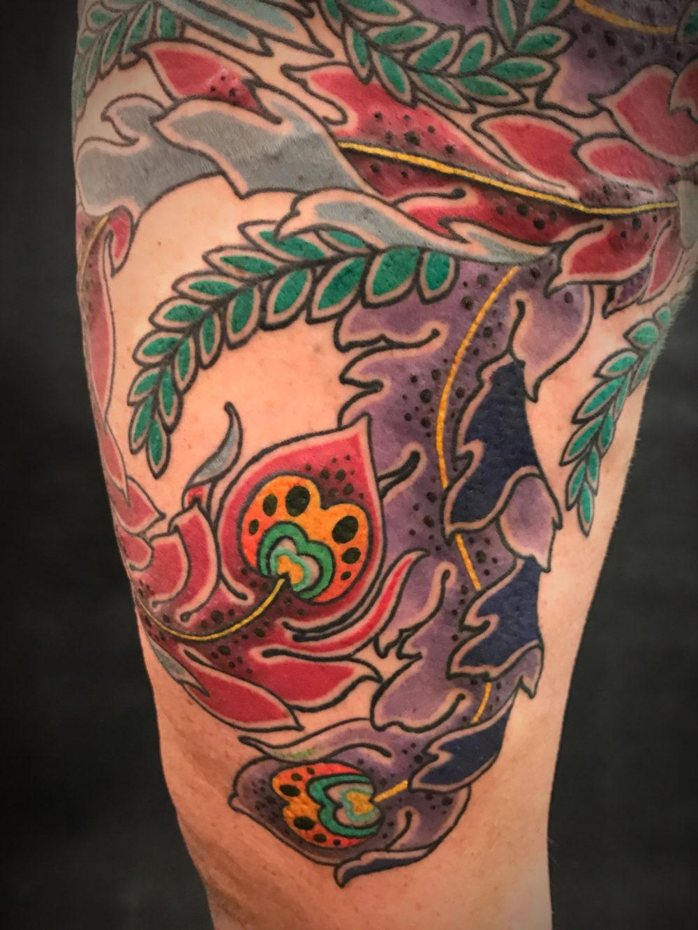 Phoenix Tail Tattoo